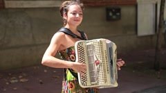 Young woman playing the accordion in the streets of Toulouse - stock footage