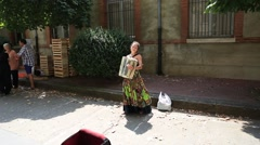 Young woman playing the accordion in the streets of Toulouse Stock Footage
