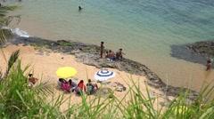People enjoy a sunny day at Boa Viagem Beach in Bahia, Brazil. Stock Footage