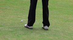 Golfer misses hole Stock Footage