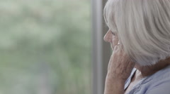4K Portrait of lonely senior lady alone with her thoughts - stock footage