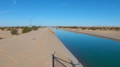 Wide Irrigation Aqueduct In California Desert Stock Footage
