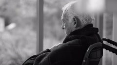 4K Black & white portrait of lonely senior man sitting by the window Arkistovideo