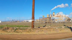 Driving By Geo Thermal Electric Power Plant- Niland, CA Stock Footage