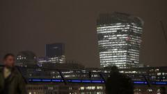 London skyline at night with silhouettes of people walking Arkistovideo