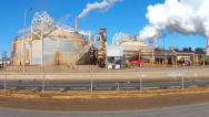 Stock Video Footage of Geo Thermal Electric Power Plant Drive By Shot- Niland CA