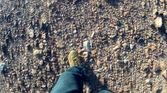 High Angle View Of Feet Of Man Walking In Rocky Desert Stock Footage