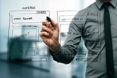 Designer drawing website development wireframe Stock Photos