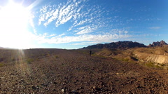 Man Stumbles Toward Camera In Barren Rocky Desert Stock Footage