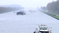 Cargo Ship in canal Misty winter day holland Stock Footage