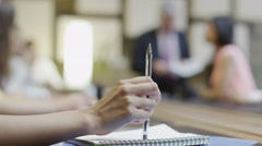 4K close up hand of businesswoman tapping her pen in a boardroom meeting - stock footage
