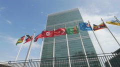 0590 Flags waving in front of United Nation Headquarter Stock Footage