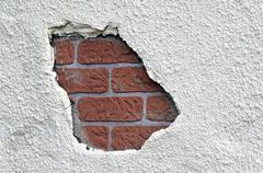 Hole in a brick wall Stock Photos