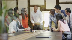 4K Mixed ethnicity business group brain storming in a meeting - stock footage