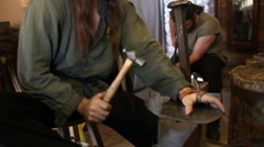 Blacksmith hammering a piece of metal Stock Footage