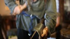 A blacksmith at a medieval fair - stock footage