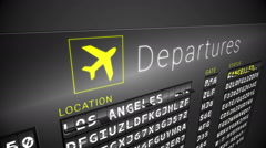 Black departures board showing cancelled flights - stock footage