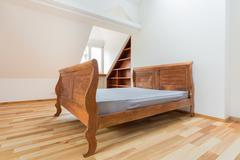 vintage bed in the attic - stock photo