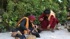 Two snake charmer enchanting cobras in a street of Manali, India. Stock Footage