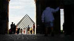 Tourists walk through arch to Louvre in Paris TL 4K Stock Footage