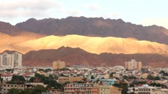 Cityscape of Eilat at the early morning on Arava desert mountains background Stock Footage