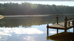 Pond in a Wooded Area Splash Dock Stock Footage