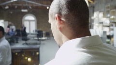 4K Diverse business group at work in busy modern office Stock Footage