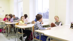 Group of students with pens sitting at school Stock Footage