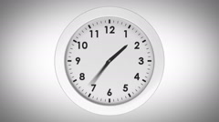 Ticking clock on white background - stock footage