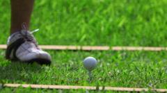 Golf strike - Golfer hitting a ball Stock Footage