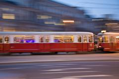 red old trolley car in vienna in the first district by night - stock photo