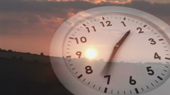 Ticking clock over sunset - stock footage