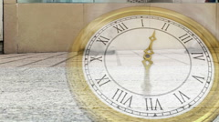 Roman numeral clock over busy street - stock footage
