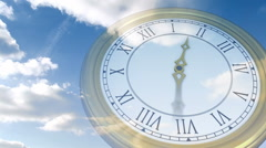 Roman numeral clock over blue sky - stock footage