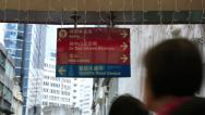 Stock Video Footage of Red street direction board and people on Central Mid Levels escalator