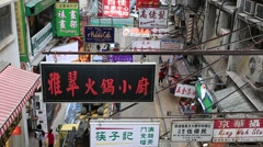 Street view with signboards in Chinese language in Hong Kong Stock Footage