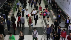 Crowds of people walking in Central MTR subway station in Hong Kong Stock Footage