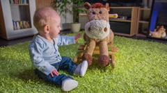 a small child caress a plush horse toy. - stock footage