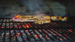 Lamb chops on grill, focus on foreground, plain view Stock Footage