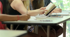 Students taking notes and doing their assignments in class. Ultra HD 4K - stock footage