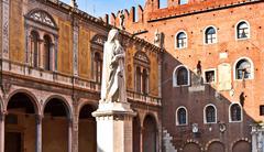 dante statue in piazza signori in verona italy - stock photo