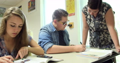Teacher helping students with their assignments. Ultra HD 4K - stock footage