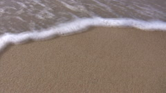 Sea wave wash away small shell Stock Footage