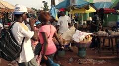 Africa men selling bread Bandim street city market Bissau Guinea Bisseau Stock Footage