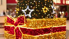 Beautiful christmas lights focus pull in shopping centre - stock footage