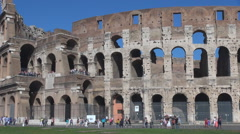 Tourist people visit Great Colosseum forum historic emblem Rome landmark sunny Stock Footage