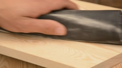 Man hand sanding pine wood Stock Footage