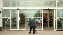 Anonymous people using automatic doors at shopping centre Stock Footage