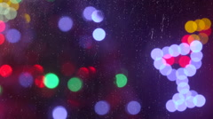 Christmas holiday out of focus lights behind a window in a rainy night Stock Footage
