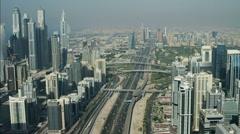 Stock Video Footage of Aerial Dubai Skyscrapers Sheikh Zayed Road desert Dubai Metro UAE